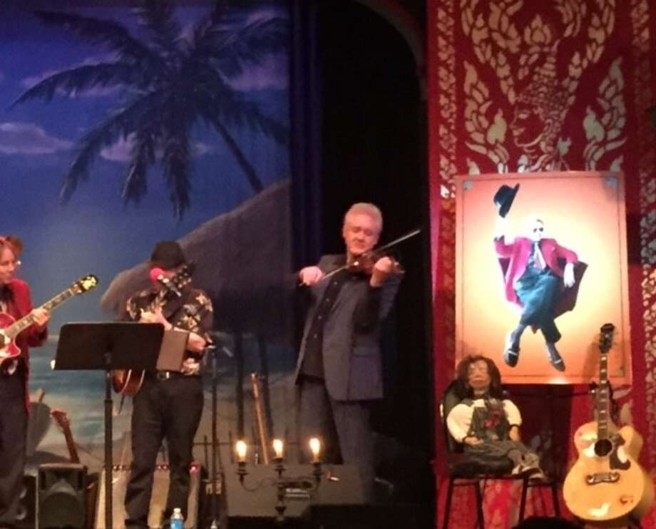 Hot Licks play at memorial gathering for Dan Hicks, whose picture is to the right