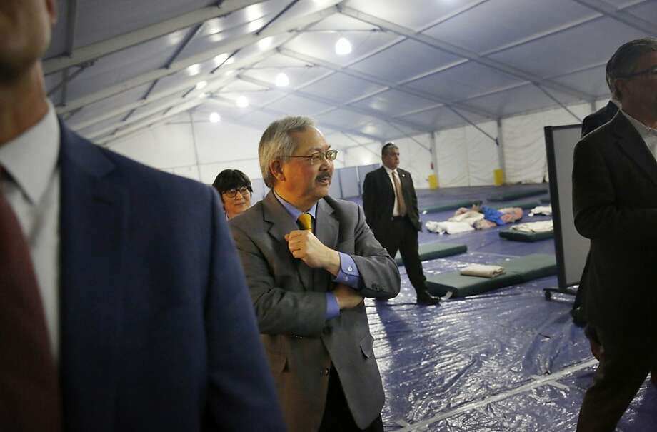 Mayor Ed Lee looks around the inside of a large tent as he tours the shelter at Pier 80 on Tuesday,  February 23, 2016 in San Francisco, California. Photo: Lea Suzuki, The Chronicle