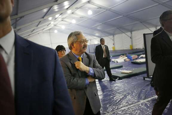 Mayor Ed Lee looks around the inside of a large tent as he tours the shelter at Pier 80 on Tuesday,  February 23, 2016 in San Francisco, California.