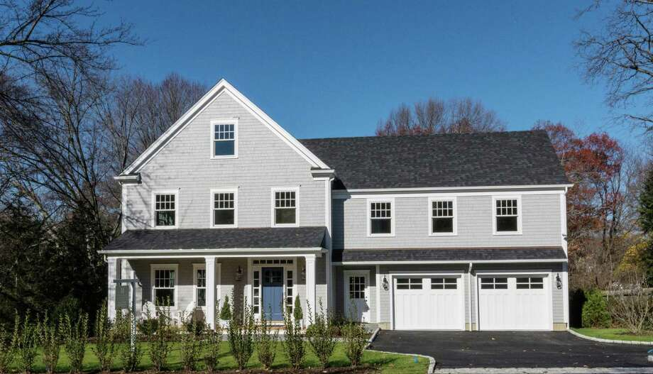 This custom 4,400-square-foot Colonial on Park Place offers four finished levels of living space with clean, contemporary finishes. Photo: Darien News / Contributed Photo / Darien News