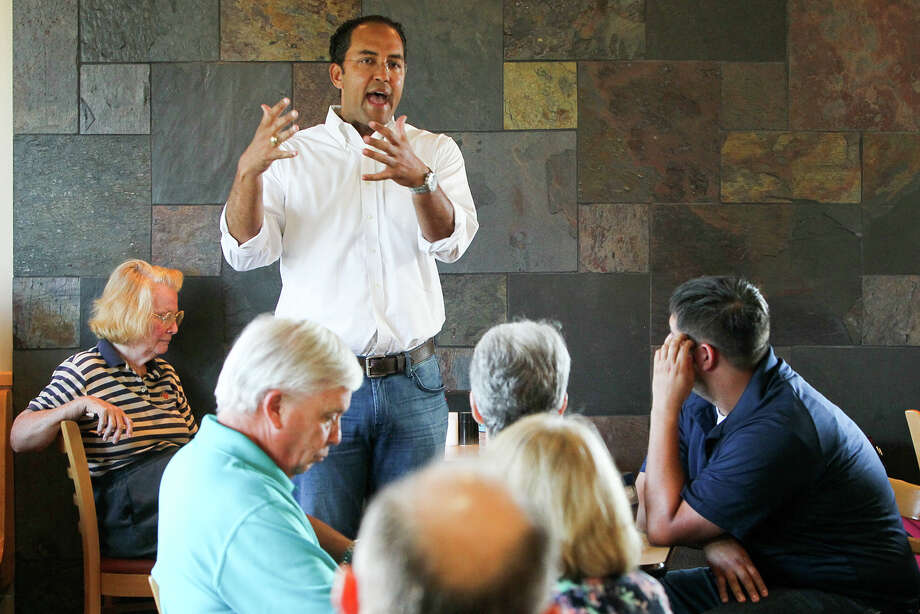 U.S. Representative Will Hurd answers questions from constituents during the kick-off of his #DC2DQ tour of #TX23 at the Helotes Dairy Queen, 12902 Bandera Rd., on Sunday, Aug. 23, 2015. Congressman Hurd is visiting all 29 counties that he represents during the summer district work period in order to meet with constituents, business owners and city and county leaders MARVIN PFEIFFER/ mpfeiffer@express-news.net Photo: Marvin Pfeiffer, Staff / San Antonio Express-News / Express-News 2015