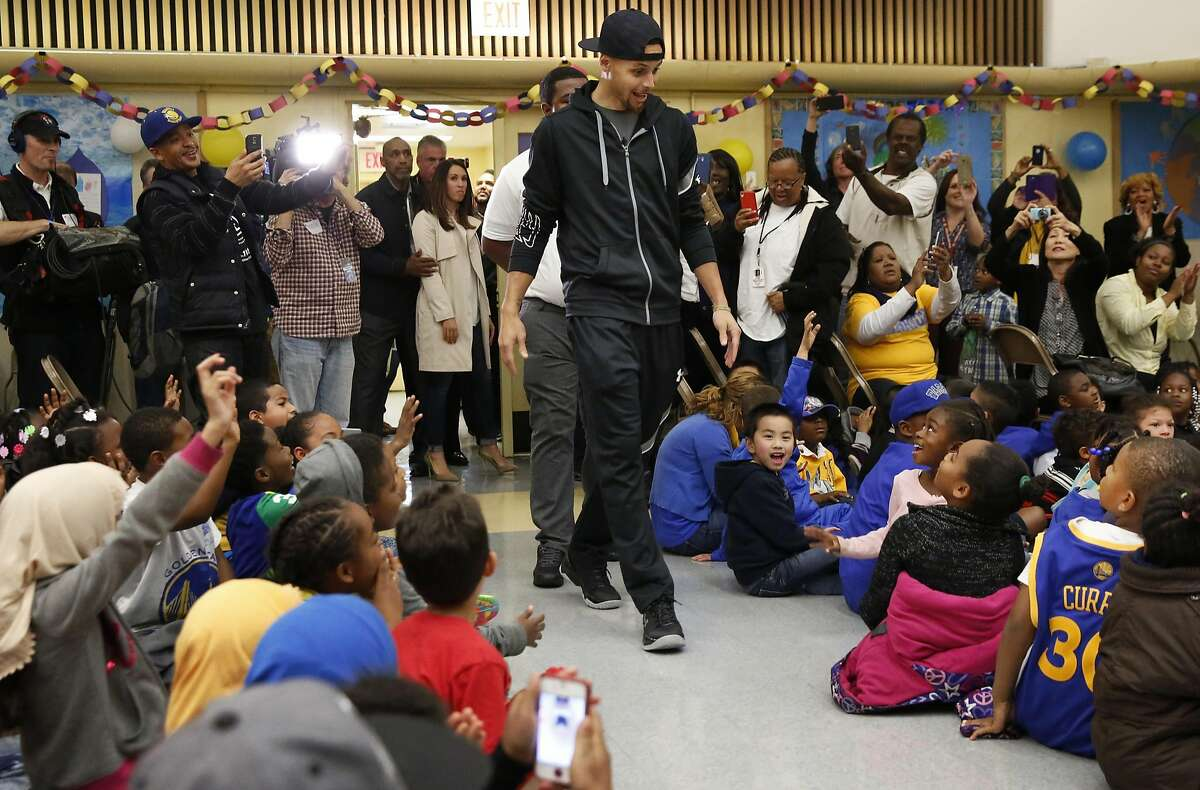 Stephen Curry enters the room to cheers from students during an event at Martin Luther King Jr. Elementary School wherein Curry promoted drinking water and healthy eating in partnership with his sponsor Brita March 8, 2016 in Oakland, Calif.