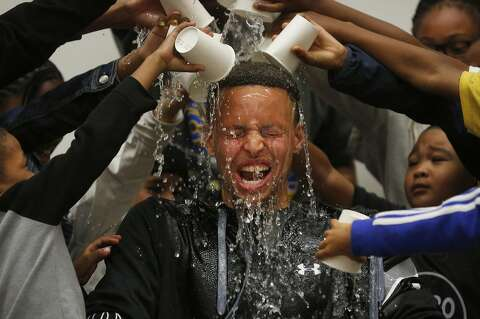 f11278c7df7d Students pour water onto Stephen Curry s head during an event at Martin  Luther King Jr.