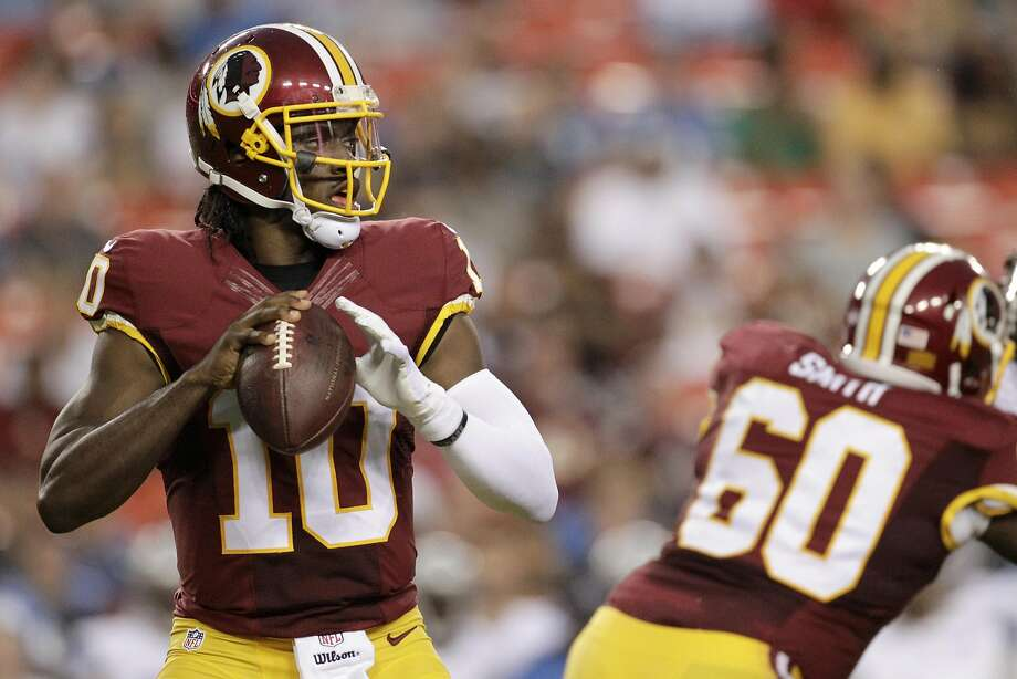 In this photo taken Aug. 20, 2015, Washington Redskins quarterback Robert Griffin III (10) passes the ball during the first half of an NFL preseason football game against the Detroit Lions in Landover, Md.  Photo: Mark Tenally, AP