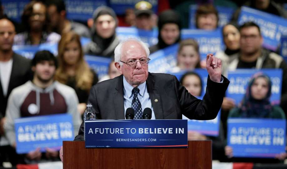 Democratic presidential candidate, Sen. Bernie Sanders, I-Vt., speaks during a campaign rally Monday in Dearborn, Mich. The senator was host of a Friday rally at Safeco Field stadium in Seattle. Photo: Charlie Neibergall, STF / AP