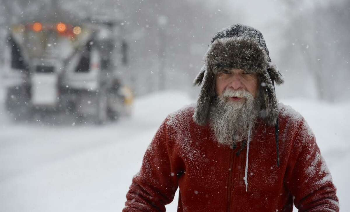 Peter O'Hearn is covered with snow as he runs his snowblower on South Main Street in Albany on Monday, Feb. 2, 2015. (Skip Dickstein / Times Union)