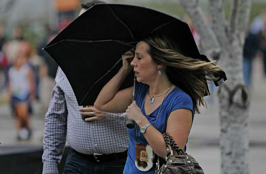 Keep the umbrella handy on Friday. The forecast warns of more thunderstorms after severe weather on Thursday night. Photo: Steve Gonzales / © 2016 Houston Chronicle