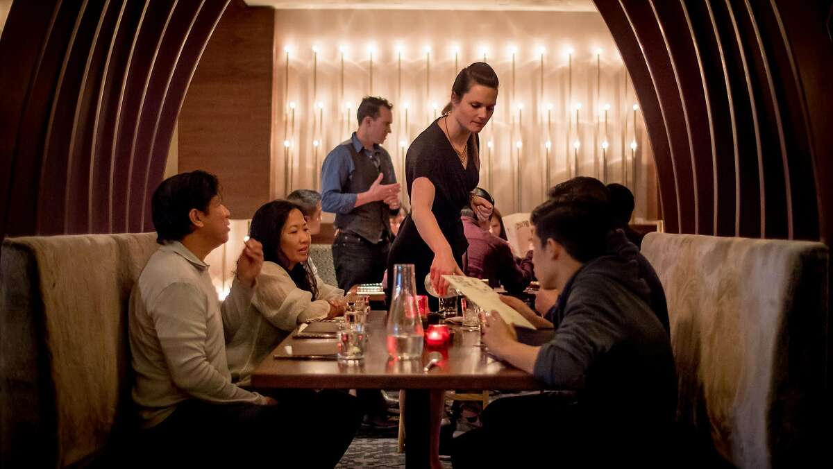 People have dinner at Cadence in San Francisco, one of the blockbuster restaurants that didn't make it a full year in business.