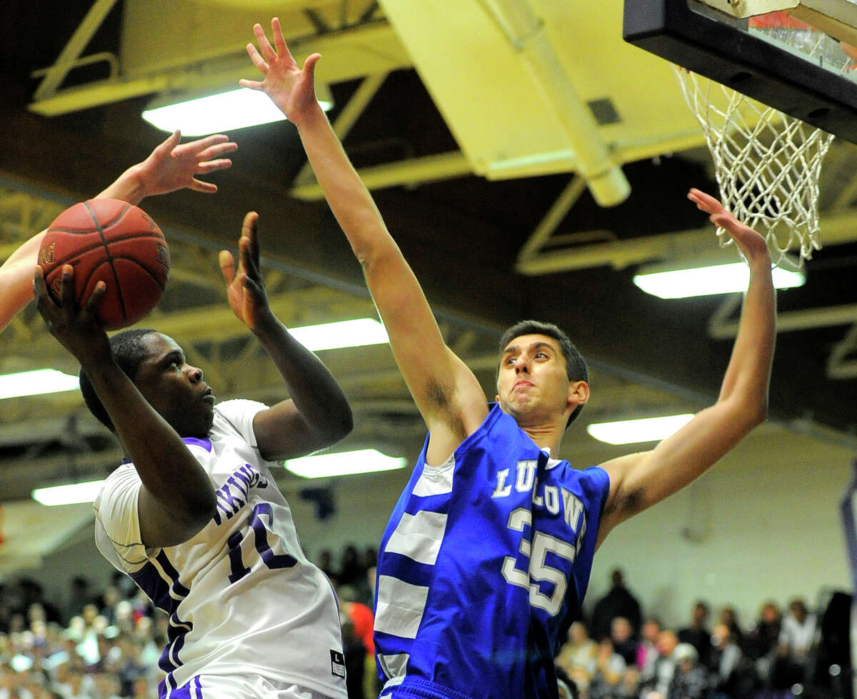 Westhill Tyrell Alexander (10) puts up a shot against Ludlowe Frank Lumaj (35) in the first round of a CIAC Class LL boys basketball championships at Westhill High School in Stamford, Conn. on March 8, 2016. Westhill defeated Ludlowe 56-46, advancing to play Fairfield Prep on Thursday.