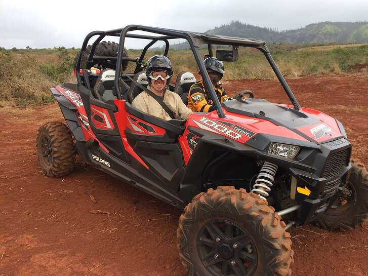 Those riding behind another utility terrain vehicle on the new Four Seasons Resort Lanai�s guided cultural tours will come back dusty, but coveralls and moist towels to freshen up are included.  Credit: Jeanne Cooper / The Chronicle