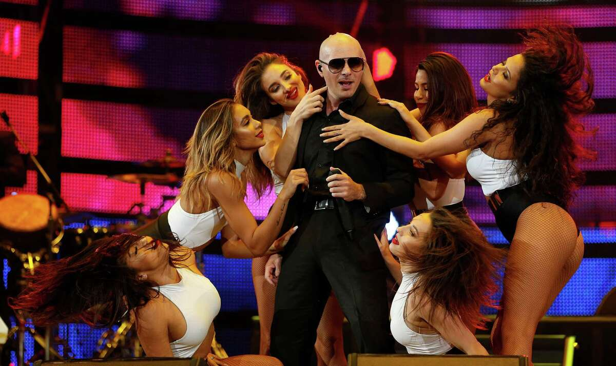 Pitbull's show Tuesday at the Houston Livestock Show and Rodeo at NRG Stadium was pretty similar to his past shows - a recitation of his hits and a bevy of backup dancers.