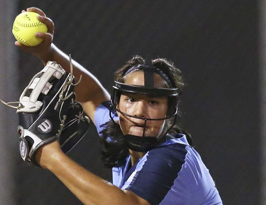 Johnson pitcher Caitlyn Colquhoun throws to first for the final out in a 7-1 win over Reagan 7-1 at the NESD Softball Complex on March 8, 2016. Photo: Tom Reel /San Antonio Express-News / 2016 SAN ANTONIO EXPRESS-NEWS