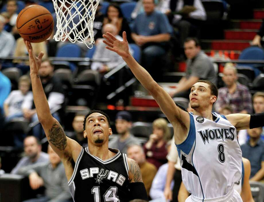 Spurs guard Danny Green scores past Minnesota Timberwolves Zach LaVine during the first quarter on March 8, Minneapolis. Photo: Andy Clayton-King /AP / FR51399 AP