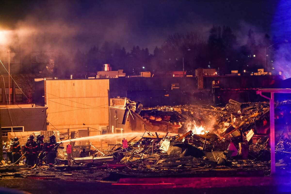 Windows were blown out in an early morning explosion in Seattle's Greenwood neighborhood. The blast leveled two buildings and injured nine firefighters who had been responding to a gas leak in the area.
