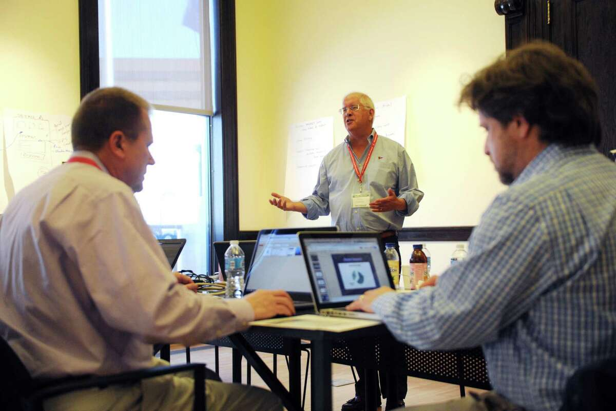 Paul Norton, center, led the formation of the winning business plan SlipShare at the April 2015 installment of Stamford Startup Weekend. The 2016 entrepreneurship contest kicks off Friday, March 18 at the Stamford Innovation Center.