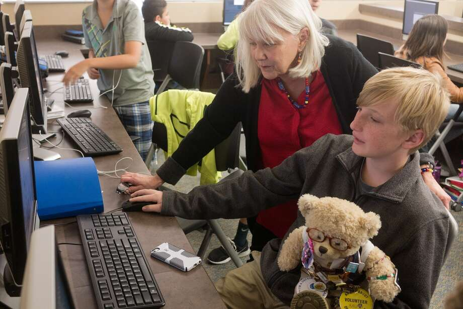 Volunteer Karen North talks game design with Luke Bailey and Ted E. Bear during a computer coding class.Volunteer Karen North talks game design with Luke Bailey and Ted E. Bear during a computer coding class. Photo: R. Clayton McKee, Freelance / ©2016 R. Clayton McKee