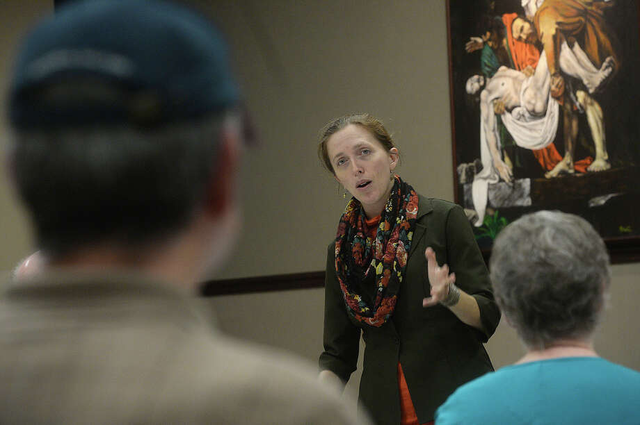 Sarah Bellian, a curator with the Museum of the Gulf Coast, describes a new historical project getting underway during a meeting of the Jefferson County Historical Commission at the Effie and Wilton Hebert Public Library in Port Neches Tuesday. The commission is organizing a survey of historically significant sites, collections and structures in the county's smaller communities. They are enlisting volunteers and local historians to aid in the project. Photo taken Tuesday, March 8, 2016 Kim Brent/The Enterprise Photo: Kim Brent Kim Brent / Beaumont Enterprise