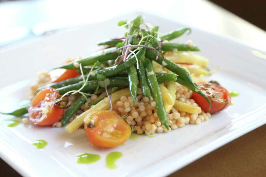 Spring Bean Salad, green beans, yellow wax beans, Israeli cous cous, roasted baby grape tomatoes, roasted tomato vinaigrette, prepared by Nathan Friend, chef de cuisine, at Current restaurant inside The Westin the Woodlands hotel. Photo: Gary Coronado Gary Coronado, Houston Chronicle / © 2015 Houston Chronicle