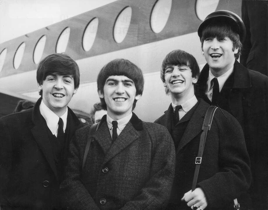 392279 03: FILE PHOTO: The Beatles, left to right, Paul McCartney, George Harrison, Ringo Starr and John Lennon (1940 - 1980) arrive at London Airport February 6, 1964, after a trip to Paris. Conflicting reports were released July 23, 2001 regarding Beatle George Harrison''s battle with cancer. Music producer Sir George Martin was quoted as saying that Harrison expects to die soon from his illnesses. The 58-year-old musician underwent treatment for a brain tumor at a clinic in Switzerland, and had surgery earlier this year for lung cancer. Photo: Getty Images / Getty Images North America