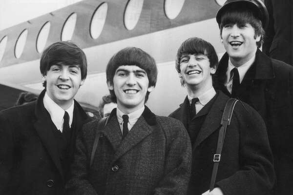 392279 03: FILE PHOTO: The Beatles, left to right, Paul McCartney, George Harrison, Ringo Starr and John Lennon (1940 - 1980) arrive at London Airport February 6, 1964, after a trip to Paris. Conflicting reports were released July 23, 2001 regarding Beatle George Harrison''s battle with cancer. Music producer Sir George Martin was quoted as saying that Harrison expects to die soon from his illnesses. The 58-year-old musician underwent treatment for a brain tumor at a clinic in Switzerland, and had surgery earlier this year for lung cancer.