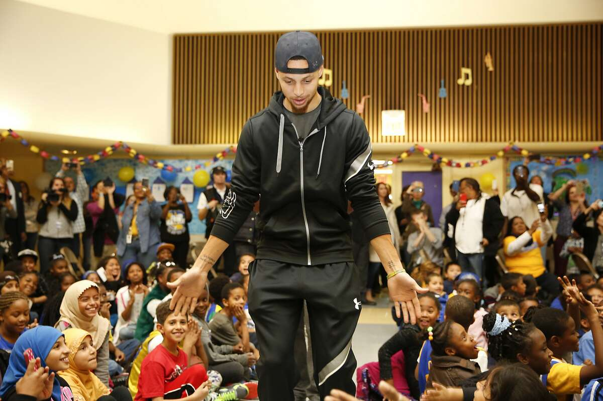 Basketball star Stephen Curry attends an event at Martin Luther King Jr. Elementary School wherein Curry promoted drinking water and healthy eating in partnership with his sponsor Brita March 8, 2016 in Oakland, Calif.
