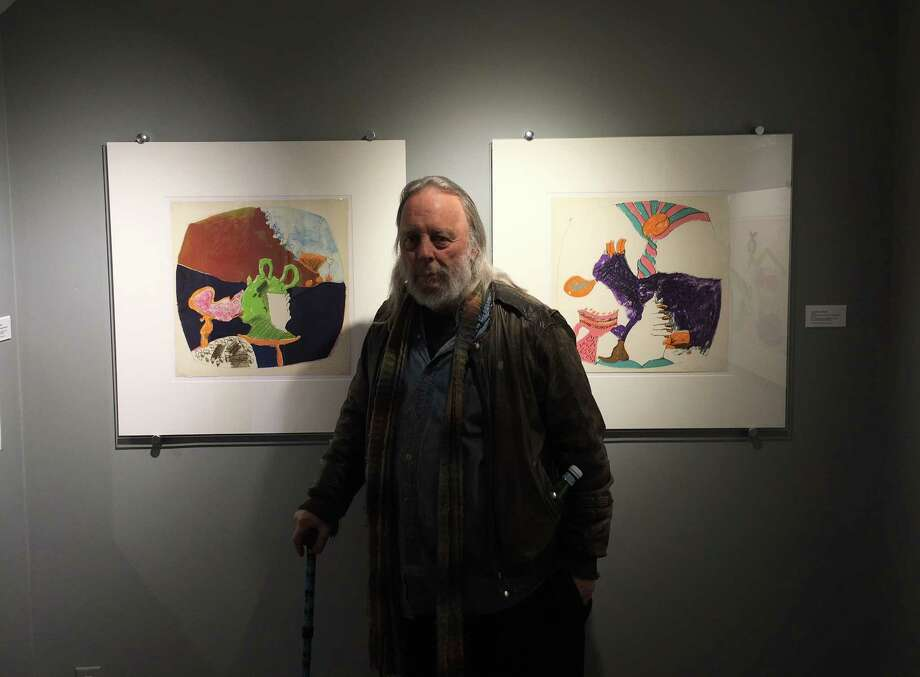 "James Reed, curator of John Altoon's ""About Women"" exhibit at the Silvermine Art Center, in front of two of Altoon's lithographs. The exhibit will run through April 8. Photo: Justin Papp / Justin Papp"