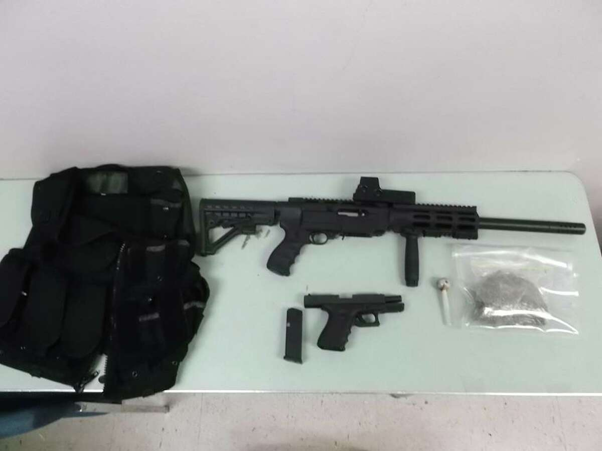 Authorities said they found a semi-automatic rifle, a semi-automatic handgun and tactical gear inside Khamprasong Thammavong's Fresno home.
