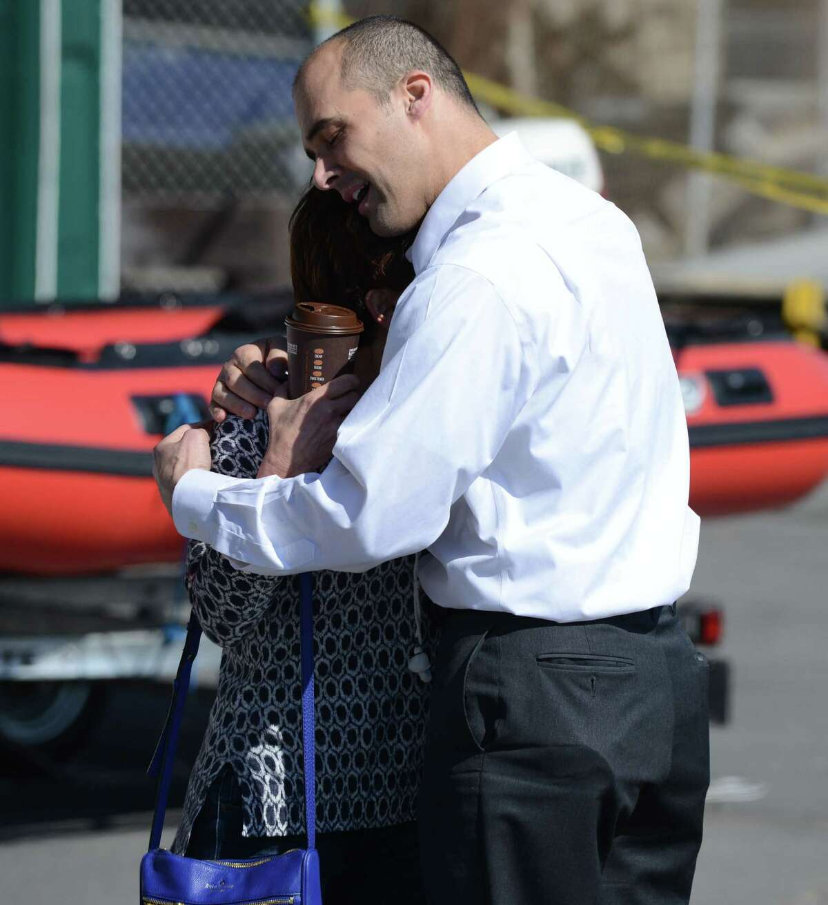An unidentified woman is consoled by a police investigator after a body was recovered from the Hudson River on Wednesday, March, 9, 2016, in Albany, N.Y. Police have yet to release an ID. Witnesses said the body was spotted at low tide. (Will Waldron/Times Union)