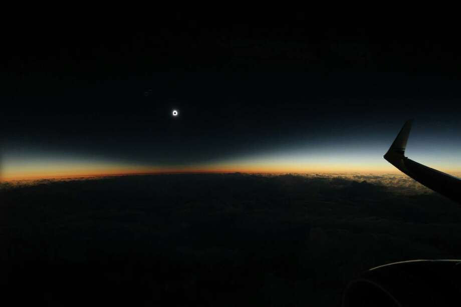 Tthe full shadow of the moon during the total solar eclipse on Tuesday, March 8, 2016, as seen from an airplane over the North Pacific Ocean.  Photo: Dan McGlaun, Multiple / Dan McGlaun/eclipse2017.org