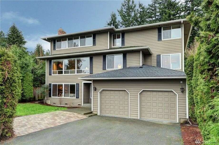 The first home, 13044 12th Ave. NW., is listed for $899,888. The four bedroom, 3.5 bathroom home has mountain and Puget Sound views and a fenced backyard.There will be a showing for this home on Sunday, March 13 from 3:30 - 6 p.m.You can see the full listing here. Photo: Jim Melgard,  Windermere Real Estate/East,  Inc.