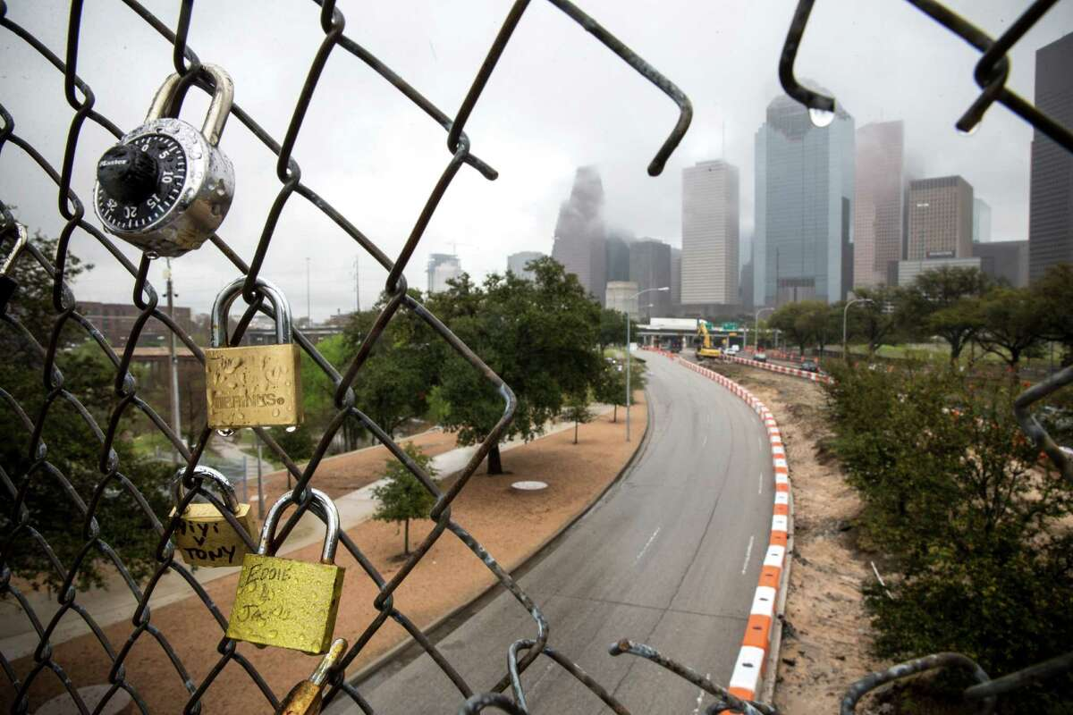 Traffic flows past construction underway along Allen Parkway on Monday, Feb. 22, 2016, in Houston. The lane on the left is slated to be parking for Eleanor Tinsley Park, once the project is completed. The center lane will be for westbound traffic.