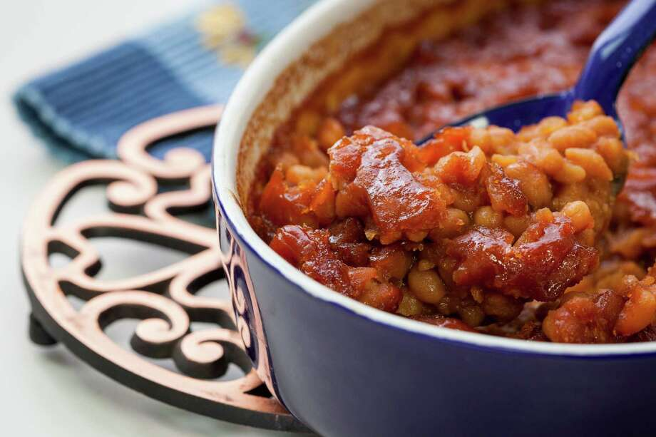 The fat in meaty baked beans can be drastically lowered by using turkey in the place of beef and pork. Photo: Michael Paulsen /Houston Chronicle / © 2012 Houston Chronicle