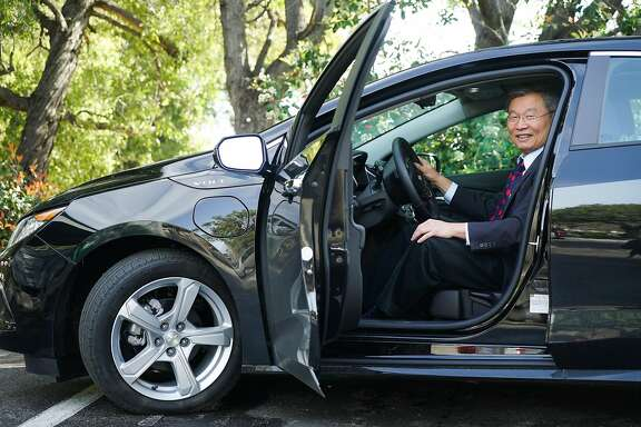 Mayor Barry Chang poses for a photograph in his electric Chevy Volt at Cupertino City Hall in Cupertino, Calif. on Wednesday, March 9, 2016. The mayor would like companies such as Apple to pay more in taxes in order to fund shuttles that would bus people to and from Caltrain.
