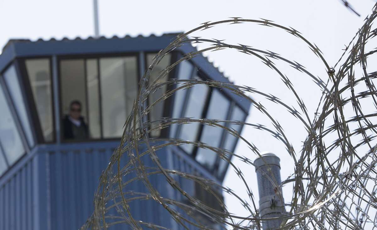 FILE - In this Wednesday, Aug. 17, 2011 file photo, concertina wire and a guard tower are seen at Pelican Bay State Prison near Crescent City, Calif.