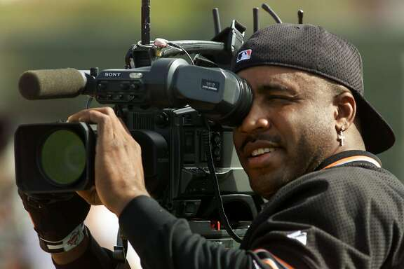 GIANTS BONDS-C-25FEB00-SP-KL ---Barry Bonds trades places with the media getting behind a TV camera, and jokes that he could be a cameraman. The Giants are in Spring Training at Indian School Park in Scottsdale.  (KENDRA LUCK/SAN FRANCISCO CHRONICLE)