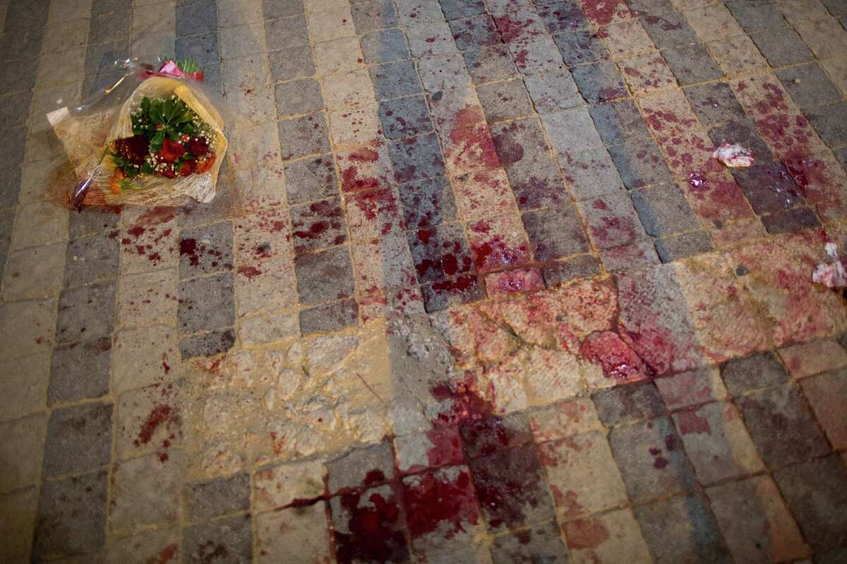 Blood stains the street at the scene of a stabbing attack in Jaffa, a mixed Jewish-Arab part of Tel Aviv, Israel, Tuesday, March 8, 2016. (AP Photo/Oded Balilty)