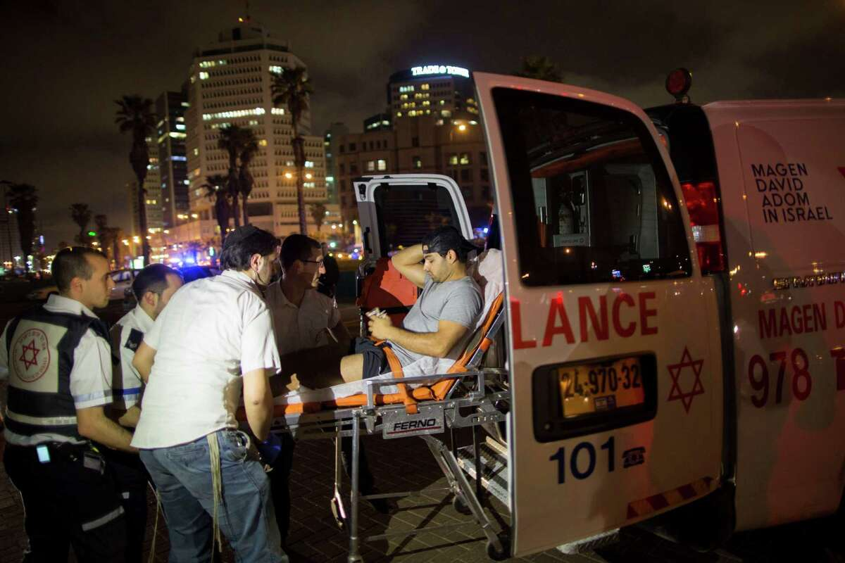 A wounded man is evacuated from the scene of a stabbing attack in Jaffa, a mixed Jewish-Arab part of Tel Aviv, Israel, Tuesday, March 8, 2016. (AP Photo/Oded Balilty)