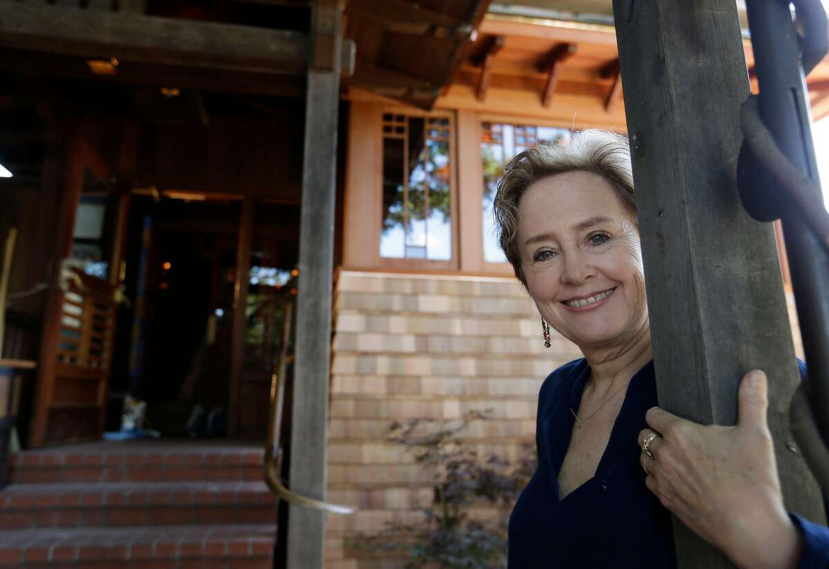 FILE - In this June 20, 2013 file photo, Alice Waters poses outside the new front entrance to her Chez Panisse restaurant in Berkeley, Calif. After a fire in March shut the doors to the famous gourmet restaurant, the eatery reopened in June. (AP Photo/Eric Risberg, File)