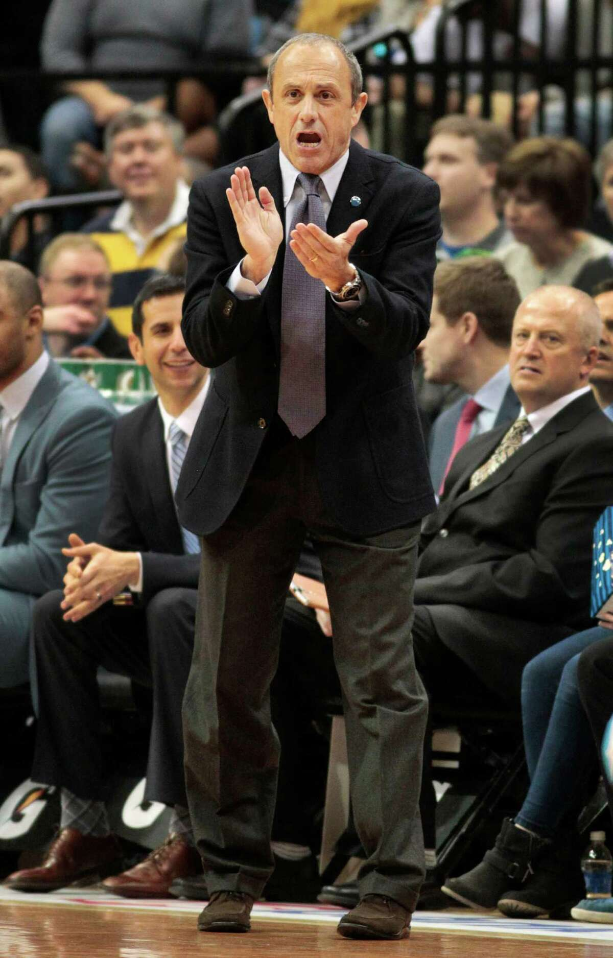Spurs assistant coach Ettore Messina applauds during the team's game against the Minnesota Timberwolves on March 8, 2016 in Minneapolis.