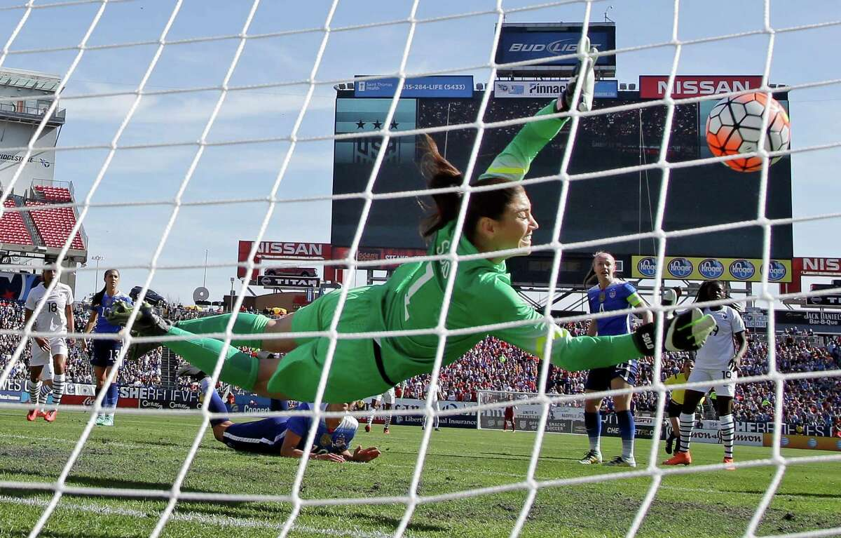 United States' goalkeeper Hope Solo (1) blocks a shot against France during the first half of a SheBelieves Cup women's soccer match Sunday, March 6, 2016, in Nashville, Tenn. The United States won 1-0. (AP Photo/Mark Humphrey) ORG XMIT: TNMH120
