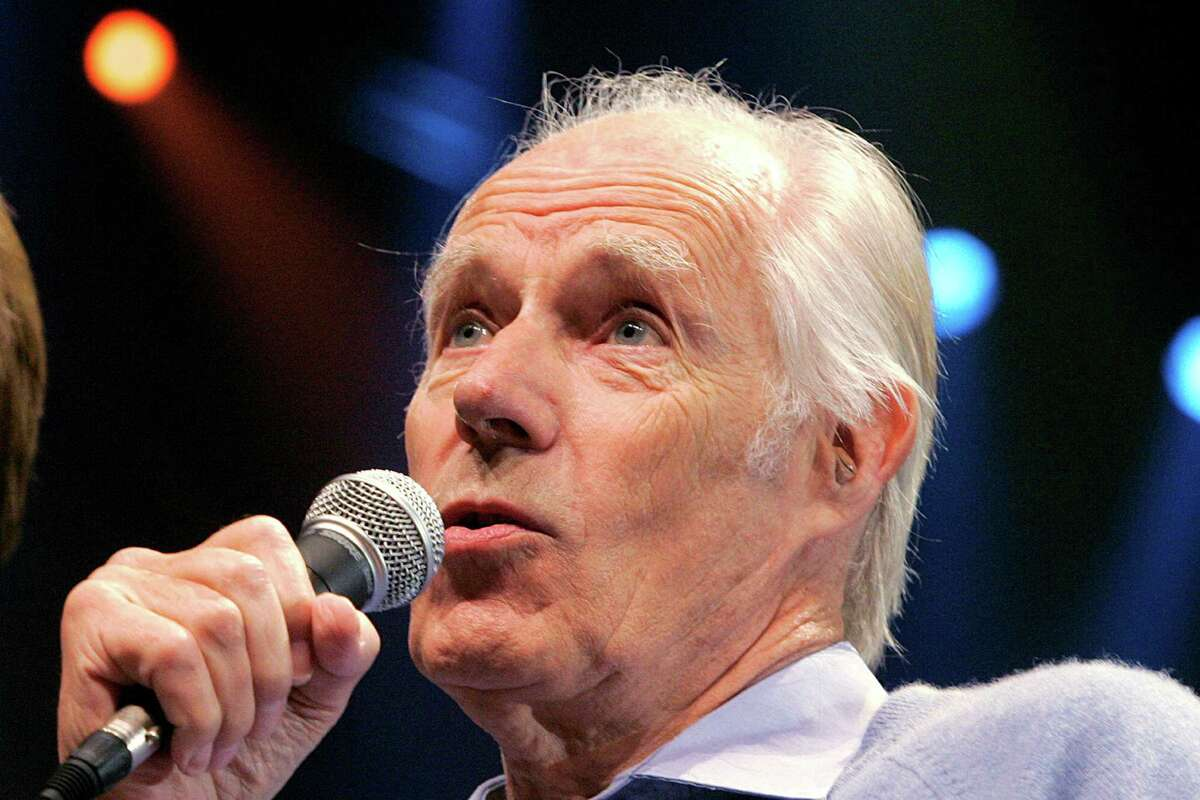 FILE - In this May 24, 2006, file photo, Beatles producer Sir George Martin answers a question from the media after the sneak preview of a new Beatles-themed Cirque du Soleil show,