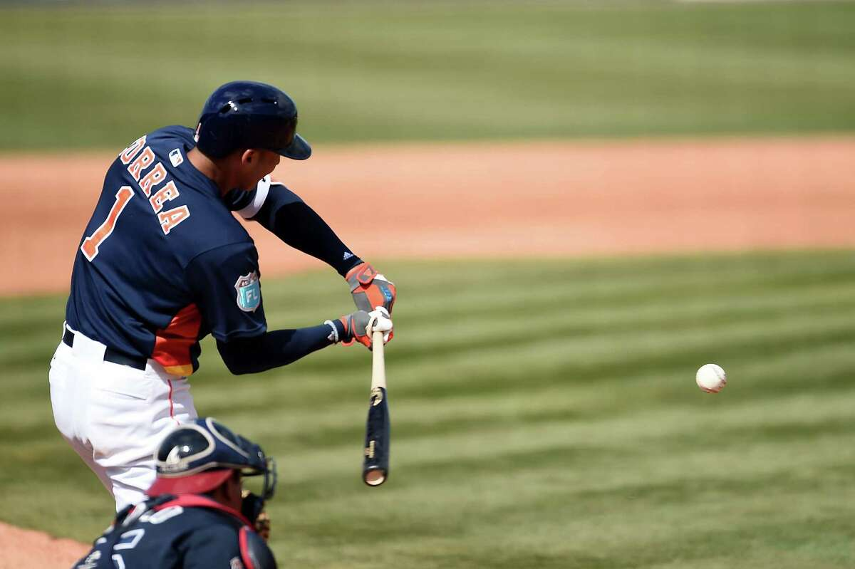 KISSIMMEE, FL - MARCH 09: Carlos Correa #1 of the Houston Astros gets a base hit during the fourth inning of a spring training game against the Atlanta Braves at Osceola County Stadium on March 9, 2016 in Kissimmee, Florida.