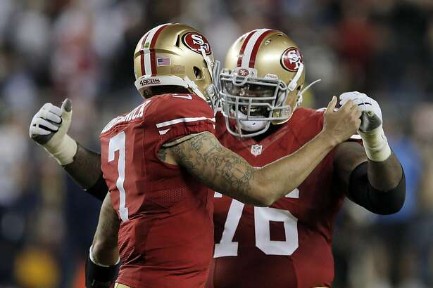 Colin Kaepernick (7) celebrates with Anthony Davis(76) after his 90-yard touchdown run during third quarter as the 49ers played the San Diego Chargers at Levi's Stadium in Santa Clara, Calif., on Saturday, December 20, 2014. The touchdown was the only score for the 49ers in the second half.