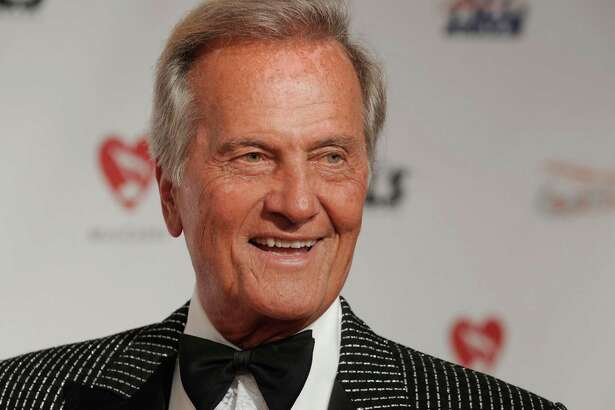 Pat Boone arrives at the MusiCares Person of the Year tribute honoring Neil Diamond on Friday, Feb. 6, 2009, in Los Angeles. (AP Photo/Chris Pizzello)