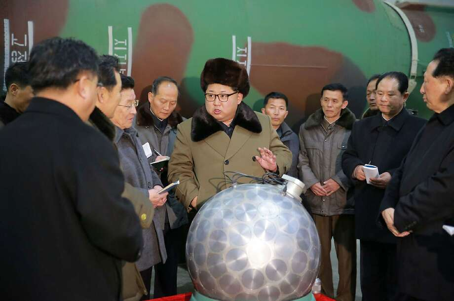 This undated picture released from North Korea's official Korean Central News Agency (KCNA) on March 9, 2016 shows North Korean leader Kim Jong-Un (C) meeting with the scientists and technicians in the field of researches into nuclear weapons and guiding the work for boosting the  nuclear arsenal at an undisclosed location. / AFP / KCNA / KCNAKCNA/AFP/Getty Images Photo: KCNA, AFP/Getty Images