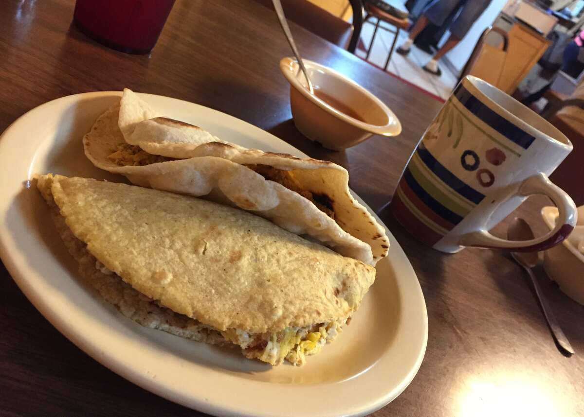 Bacon and egg on corn, chorizo and egg on flour and a cup of coffee at Mittman Fine Foods.