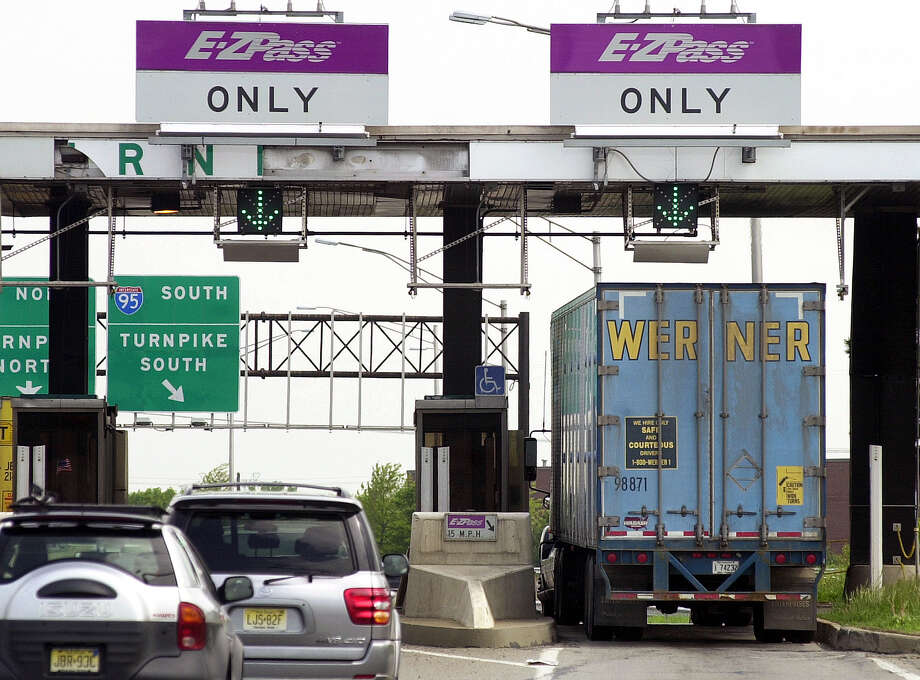 In this May 12, 2003, file photograph, cars and a truck go through the E-ZPass lanes at Exit 8A of the New Jersey Turnpike in Monroe Township, N.J. Divorce lawyers are finding that E-ZPass might be an easy way to catch cheating spouses, or to glean other useful pieces of information. Besides allowing drivers to go through toll plazas without forking over cash, E-Z Pass and other electronic toll collection systems leave a record of where the drivers have been, and when. (AP Photo/Daniel Hulshizer) Photo: Daniel Hulshizer / AP / AP
