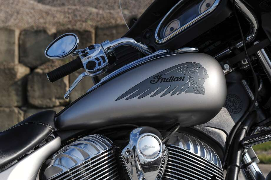 "Stock graphics and beautiful detail on the heads of the ""Silver Smoke"" Chieftain. Audio and LED menu buttons are seen on the controls. Photo: Indian Motorcycle"