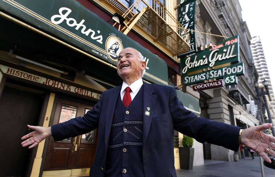 Gus Konstin, an immigrant from Greece, greets customers as they arrive at his John's Grill in 2020, which he turned into a shrine to writer Dashiell Hammett. Photo: The Chronicle 2010