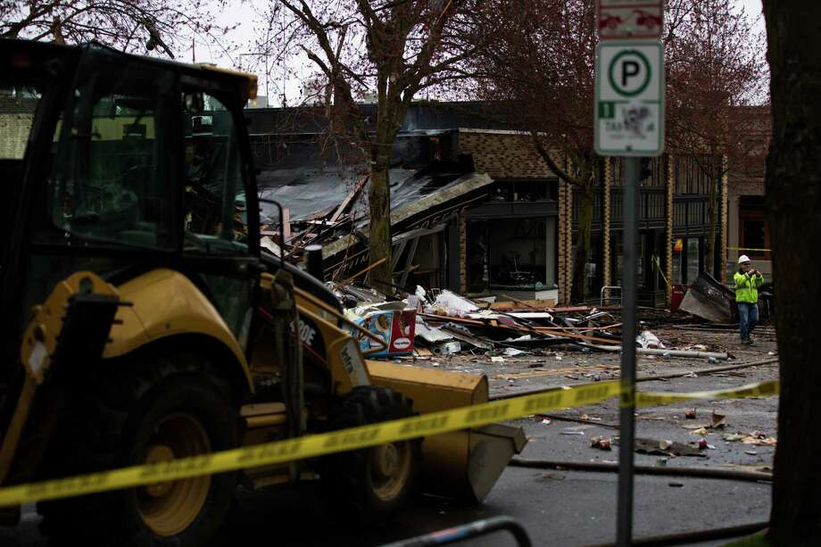 Debris litters Greenwood Avenue N. following a gas explosion earlier in the morning, Wednesday, Mar. 9, 2016. Photo: GRANT HINDSLEY, SEATTLEPI.COM / SEATTLEPI.COM
